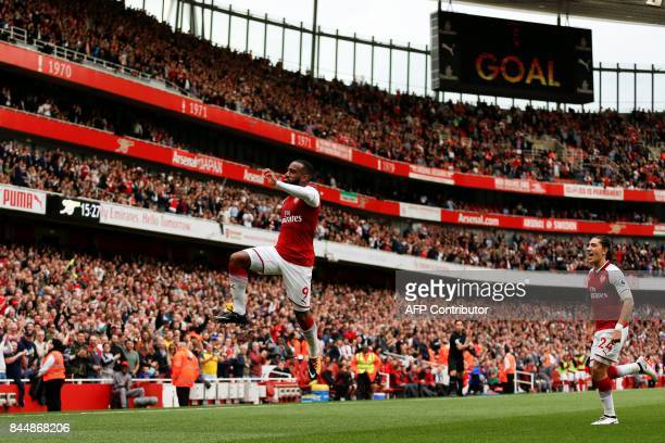 Arsenal's French striker Alexandre Lacazette celebrates scoring their second goal during the English Premier League football match between Arsenal...
