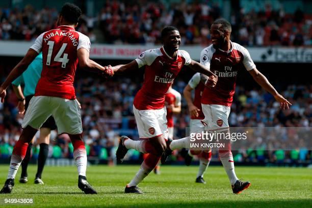 Arsenal's French striker Alexandre Lacazette celebrates scoring their fourth goal with Arsenal's English midfielder Ainsley MaitlandNiles and...