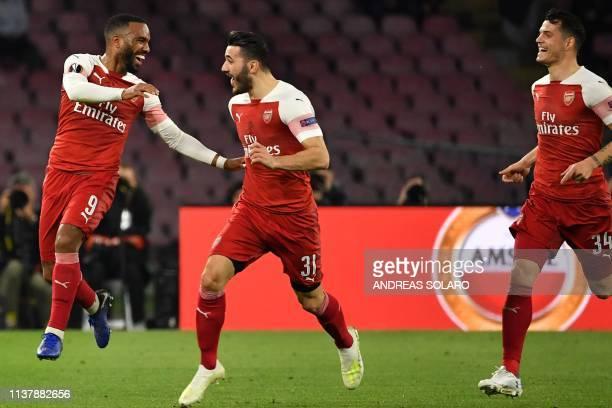 Arsenal's French striker Alexandre Lacazette celebrates with Arsenal's Germanborn Bosnian defender Sead Kolasinac and Arsenal's Swiss midfielder...