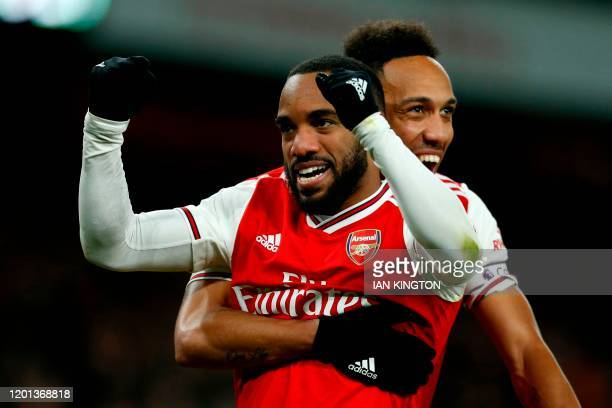Arsenal's French striker Alexandre Lacazette celebrates with Arsenal's Gabonese striker PierreEmerick Aubameyang after scoring their fourth goal...
