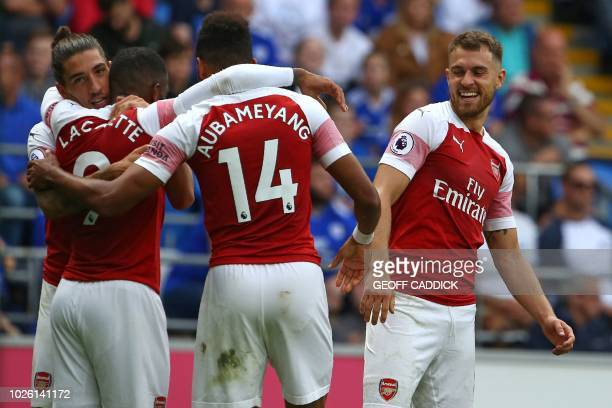 Arsenal's French striker Alexandre Lacazette celebrates with teammates after scoring their third goal during the English Premier League football...