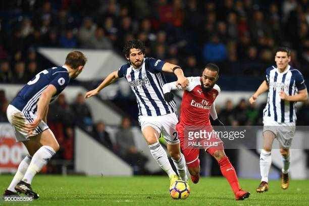 Arsenal's French striker Alexandre Lacazette is fouled by West Bromwich Albion's Egyptian defender Ahmed Hegazy during the English Premier League...