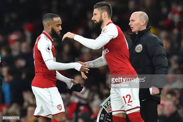 Arsenal's French striker Alexandre Lacazette is substituted for Arsenal's French striker Olivier Giroud during the English Premier League football...