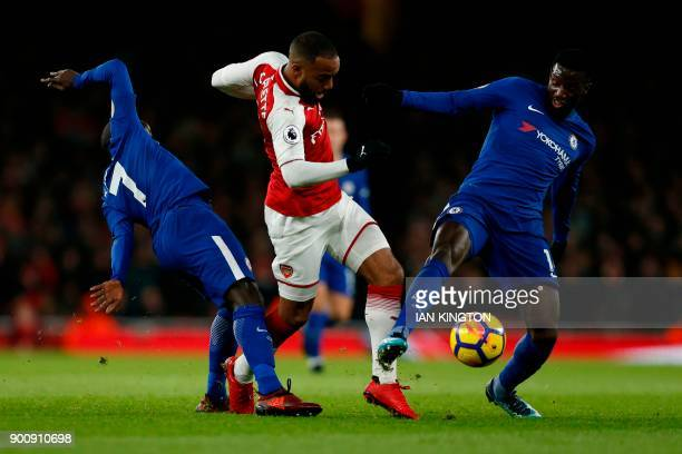 Arsenal's French striker Alexandre Lacazette is tackled by Chelsea's French midfielder N'Golo Kante and Chelsea's French midfielder Tiemoue Bakayoko...