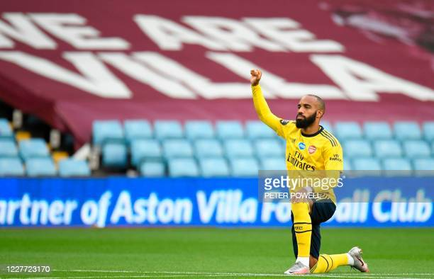 Arsenal's French striker Alexandre Lacazette kneels during the English Premier League football match between Aston Villa and Arsenal at Villa Park in...