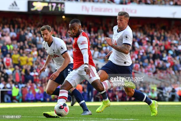 Arsenal's French striker Alexandre Lacazette prepares to shoot and score their first goal during the English Premier League football match between...