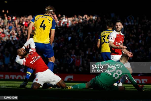 Arsenal's French striker Alexandre Lacazette reacts after missing a shot on goal during the English Premier League football match between Arsenal and...