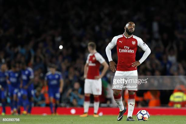 Arsenal's French striker Alexandre Lacazette reacts as Leicester celebrate their third goal during the English Premier League football match between...