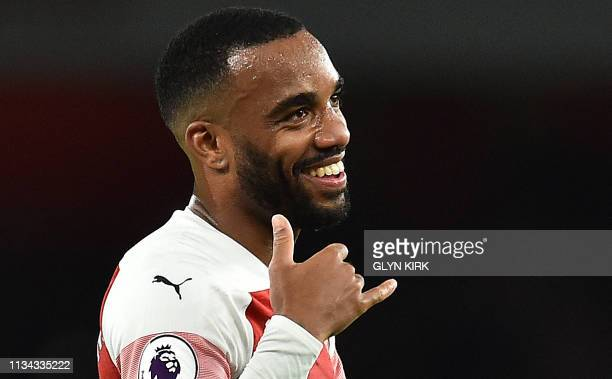 Arsenal's French striker Alexandre Lacazette reacts at the final whistle after the English Premier League football match between Arsenal and...