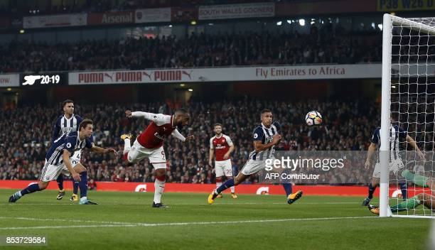 Arsenal's French striker Alexandre Lacazette scores his team's first goal during the English Premier League football match between Arsenal and West...