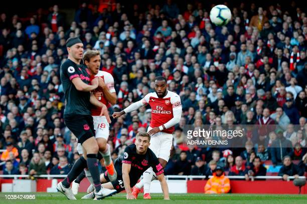 Arsenal's French striker Alexandre Lacazette scores the opening goal during the English Premier League football match between Arsenal and Everton at...