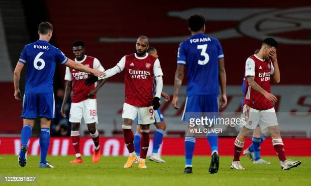 Arsenal's French striker Alexandre Lacazette shakes hands with Leicester City's Northern Irish defender Jonny Evans after the English Premier League...