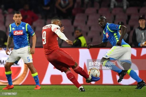 Arsenal's French striker Alexandre Lacazette shoots to score a free-kick during the UEFA Europa League quarter-final second leg football match Napoli...