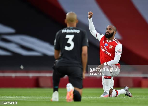 Arsenal's French striker Alexandre Lacazette takes a knee in support of the Black Lives Matter movement during the English Premier League football...