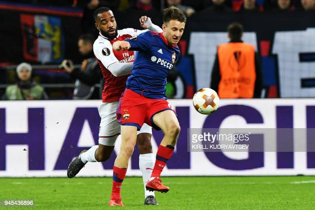 Arsenal's French striker Alexandre Lacazette vies CSKA Moscow's Russian midfielder Aleksandr Golovin during the UEFA Europa League second leg...