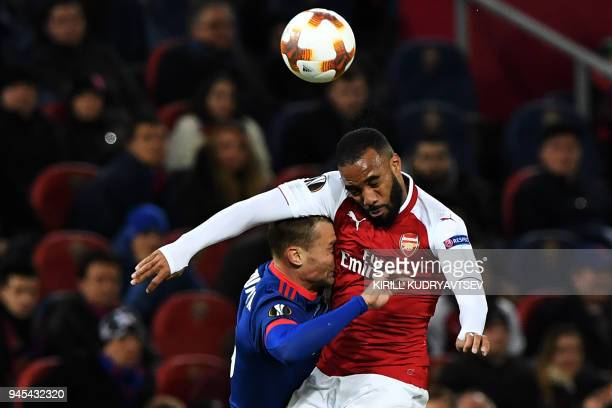 TOPSHOT Arsenal's French striker Alexandre Lacazette vies for the ball against CSKA Moscow's Russian defender Aleksei Berezutski during the UEFA...