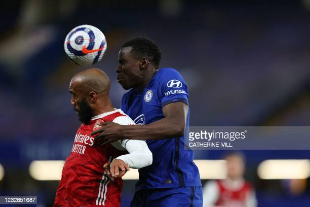 Arsenal's French striker Alexandre Lacazette vies with Chelsea's French defender Kurt Zoumaduring the English Premier League football match between...