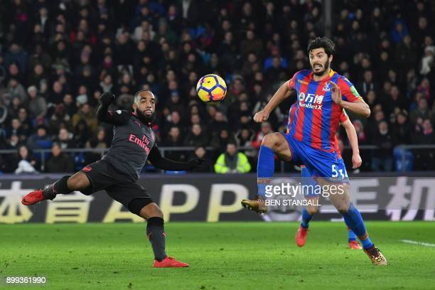 TOPSHOT Arsenal's French striker Alexandre Lacazette vies with Crystal Palace's English defender James Tomkins during the English Premier League...
