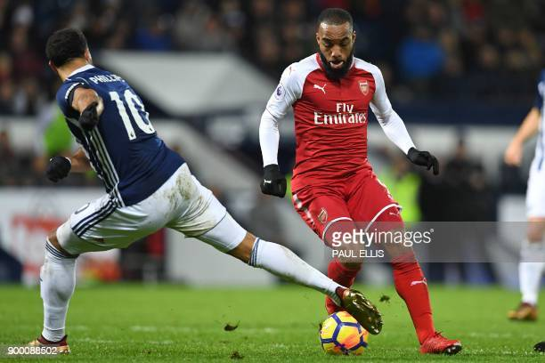 Arsenal's French striker Alexandre Lacazette vies with West Bromwich Albion's Englishborn Scottish midfielder Matt Phillips during the English...