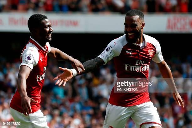Arsenal's French striker Alexandre Lacazette with Arsenal's English midfielder Ainsley MaitlandNiles celebrates scoring their fourth goal during the...