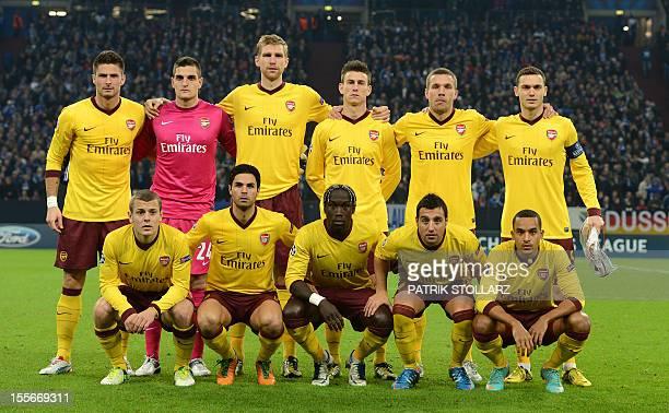 Arsenal's French striker Olivier Giroud Arsenal's Italian goalkeeper Vito MannoneArsenal's German defender Per Mertesacker Arsenal's Belgian defender...
