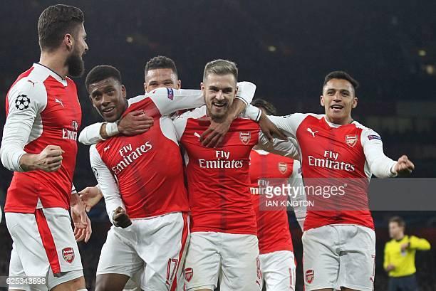Arsenal's French striker Olivier Giroud Arsenal's Nigerian striker Alex Iwobi Arsenal's Welsh midfielder Aaron Ramsey and Arsenal's Chilean striker...