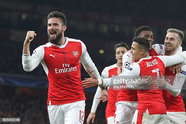 TOPSHOT Arsenal's French striker Olivier Giroud celebrates after Paris SaintGermain's Italian midfielder Marco Verratti scored an own goal for...