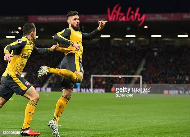 Arsenal's French striker Olivier Giroud celebrates after scoring their third goal during the English Premier League football match between...