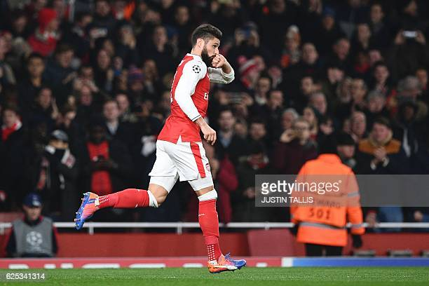 Arsenal's French striker Olivier Giroud celebrates scoring an equalising goal from the penalty spot for 11 during the UEFA Champions League group A...