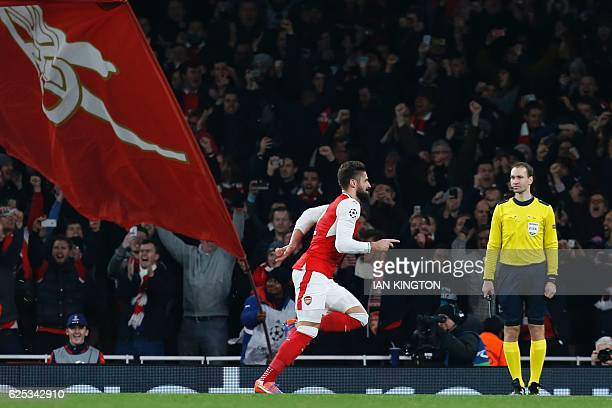 Arsenal's French striker Olivier Giroud celebrates scoring an equalising goal for 11 from the penalty spot during the UEFA Champions League group A...