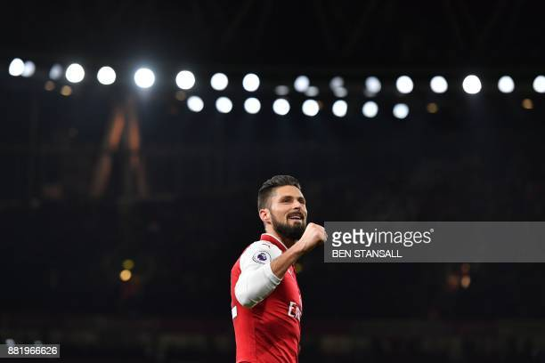 TOPSHOT Arsenal's French striker Olivier Giroud celebrates scoring their second goal during the English Premier League football match between Arsenal...