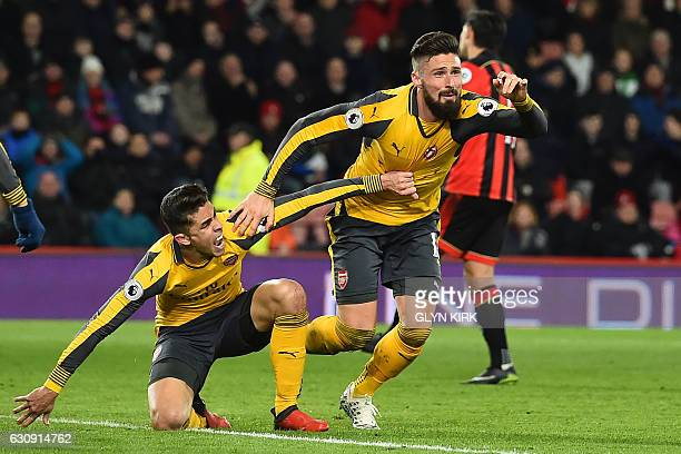 Arsenal's French striker Olivier Giroud celebrates with Arsenal's Brazilian defender Gabriel after scoring their third goal during the English...