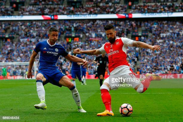 Arsenal's French striker Olivier Giroud crosses the ball in the build up to Arsenal's second goal during the English FA Cup final football match...
