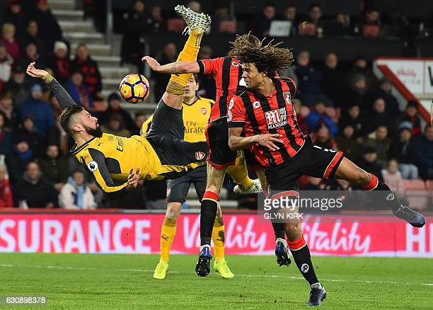 TOPSHOT Arsenal's French striker Olivier Giroud fails to connect with this overhead shot during the English Premier League football match between...