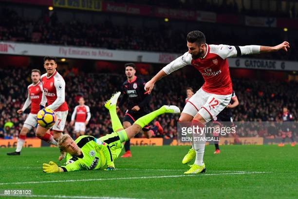 Arsenal's French striker Olivier Giroud misses a chance during the English Premier League football match between Arsenal and Huddersfield Town at the...