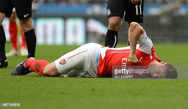Arsenal's French striker Olivier Giroud punches the ground as he lies injured during the English Premier League football match between Newcastle and...