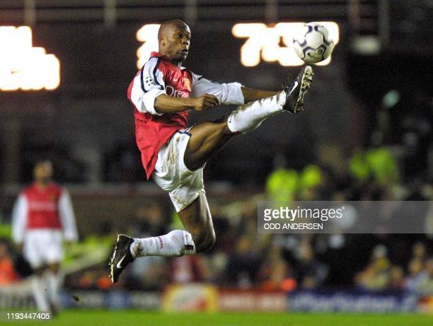 Arsenal's French striker Sylvain Wiltort flies through the air to control a pass 04 April 2001 during the UEFA Champions League quarter-final, 1st...