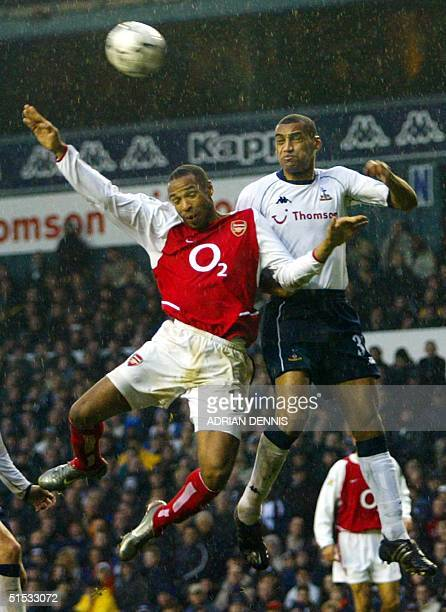 Arsenal's French striker Thierry Henry competes for the ball against Dean Richards of Tottenham Hotspur during the Premiership match at White Hart...