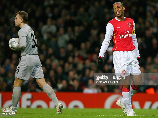 Arsenal's French striker Thierry Henry despairs as he has his goal attempt saved by CSKA Moscow goalkeeper Igor Akinfeev during their Champions...