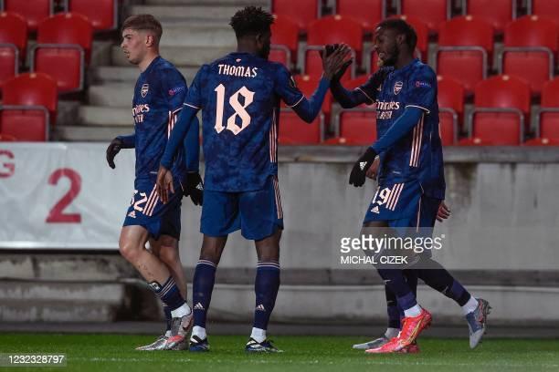 Arsenal's French-born Ivorian midfielder Nicolas Pepe celebrates scoring with his team-mate Arsenal's Ghanaian midfielder Thomas Partey during the...