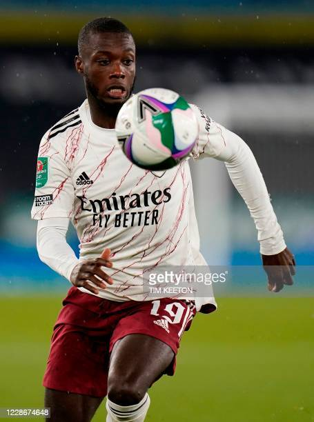 Arsenal's French-born Ivorian midfielder Nicolas Pepe controls the ball during the English League Cup third round football match between Leicester...