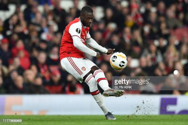 Arsenal's Frenchborn Ivorian midfielder Nicolas Pepe takes a freekick to scores his team's second goal during their UEFA Europa league Group F...