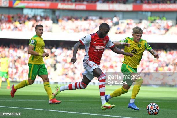 Arsenal's French-born Ivorian midfielder Nicolas Pepe vies with Norwich City's English defender Brandon Williams during the English Premier League...