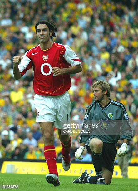 Arsenal's Frenchman Robert Pires celebrates his goal against Norwich during their Premiership match 28th August, 2004 at Norwich. AFP PHOTO/CARL DE...