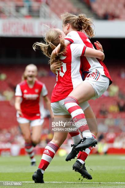 Arsenal's Freya Jupp celebrates with teammates after scoring a goal during the pre-season friendly women's football match between Arsenal and Chelsea...