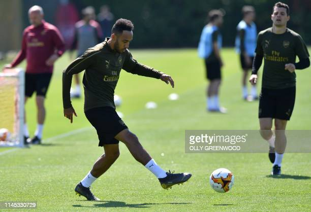 Arsenal's Gabonese striker Pierre-Emerick Aubameyang and Arsenal's Swiss midfielder Granit Xhaka attend a training session at Arsenal's London Colney...
