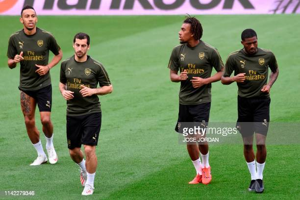 Arsenal's Gabonese striker Pierre-Emerick Aubameyang, Arsenal's Armenian midfielder Henrikh Mkhitaryan, Arsenal's Nigerian striker Alex Iwobi and...