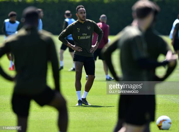 Arsenal's Gabonese striker Pierre-Emerick Aubameyang attends a training session at Arsenal's London Colney training centre in St. Albans on May 21,...