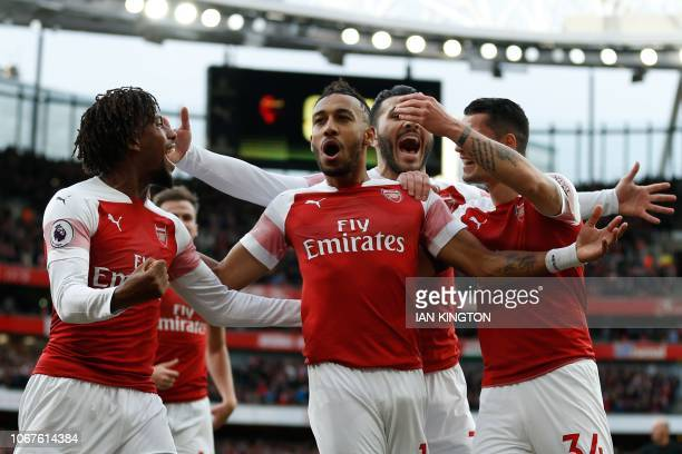 Arsenal's Gabonese striker PierreEmerick Aubameyang celebrates after scoring the opening goal from the penalty spot during the English Premier League...