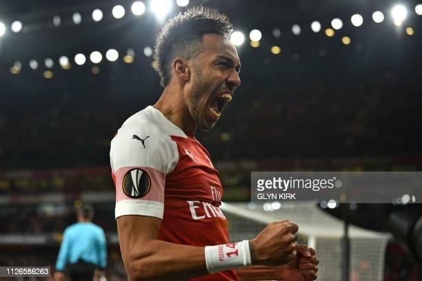 Arsenal's Gabonese striker PierreEmerick Aubameyang celebrates after his cross is deflected into the net by BATE Borisov's Belarusian defender Zakhar...